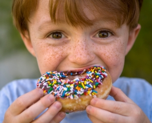 boy eating donut